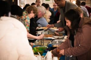 The Congregation Enjoys an Oneg Shabbat Meal