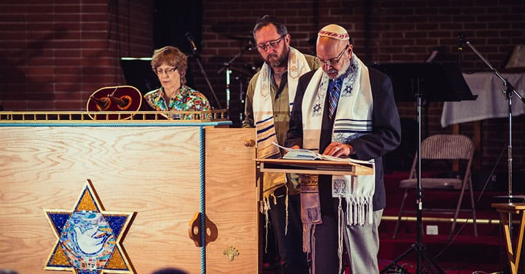 Reading of the Torah Portion during a Shabbat Service at Son of David Congregation